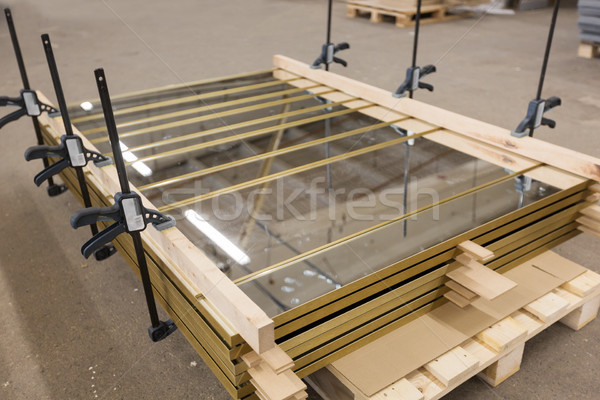 mirror panels with bar clamps at furniture factory Stock photo © dolgachov