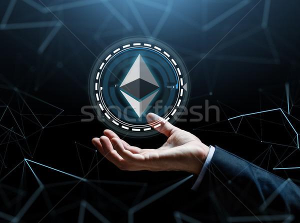 businessman hand with ethereum over binary code Stock photo © dolgachov