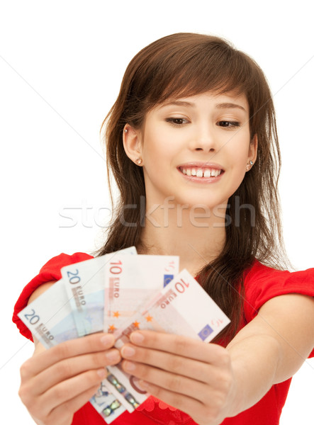 teenage girl with euro cash money Stock photo © dolgachov