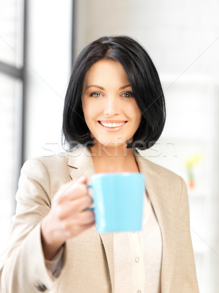 lovely businesswoman with mug Stock photo © dolgachov