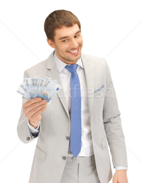 handsome man with euro cash money Stock photo © dolgachov