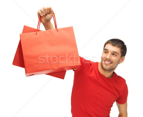 man with shopping bags Stock photo © dolgachov