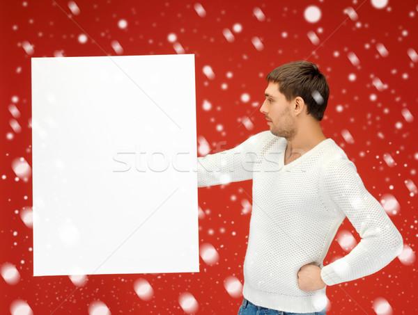 handsome man with big blank board Stock photo © dolgachov