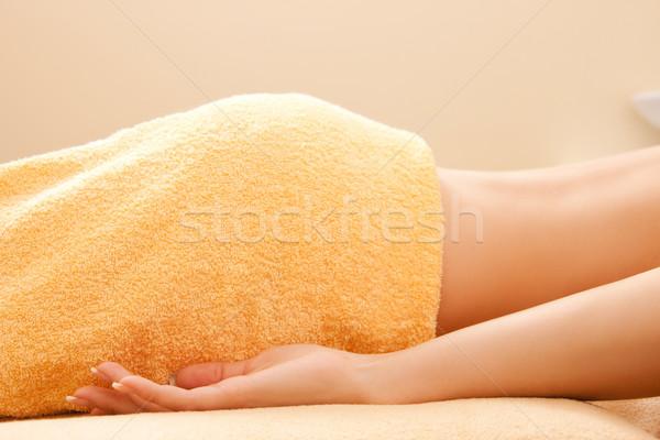 woman lying on massage table Stock photo © dolgachov