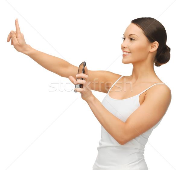Stockfoto: Vrouw · smartphone · werken · iets · denkbeeldig