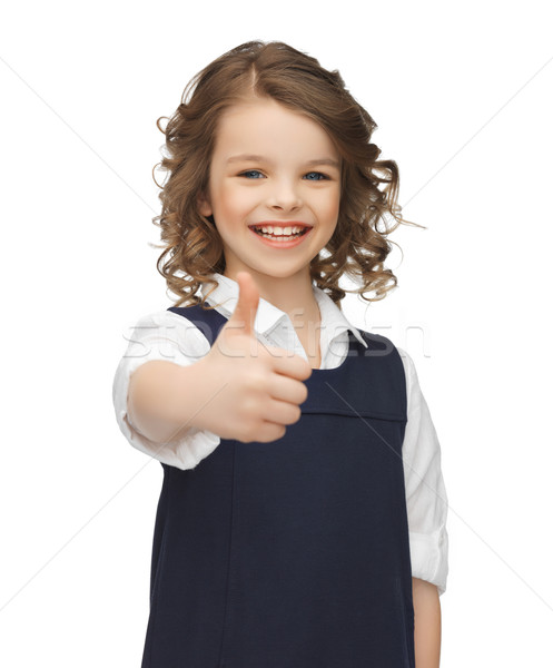 pre-teen girl showing thumbs up Stock photo © dolgachov