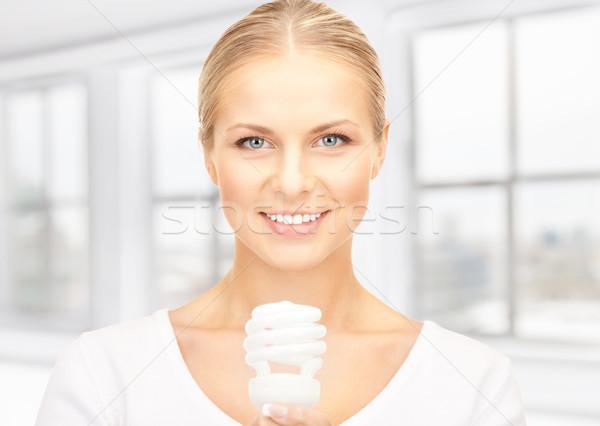 Donna energia lampadina luminoso Foto d'archivio © dolgachov