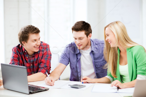 students chatting in lecture at school Stock photo © dolgachov