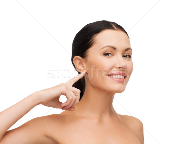 young calm woman pointing to her ear Stock photo © dolgachov