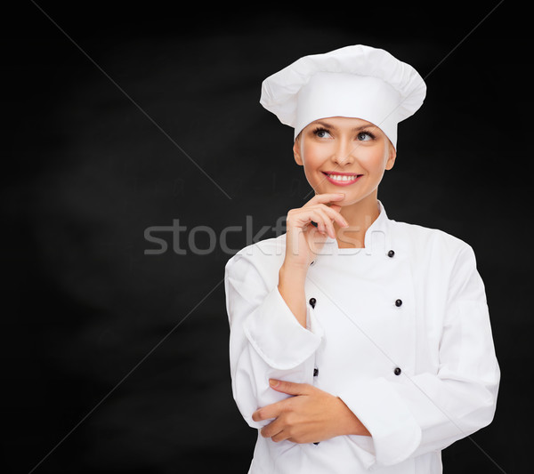 smiling female chef dreaming Stock photo © dolgachov