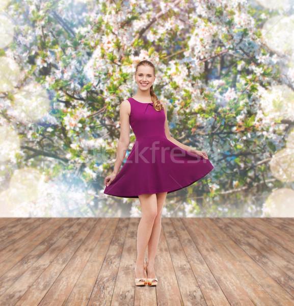 Jonge vrouw paars jurk schoonheid mode Stockfoto © dolgachov