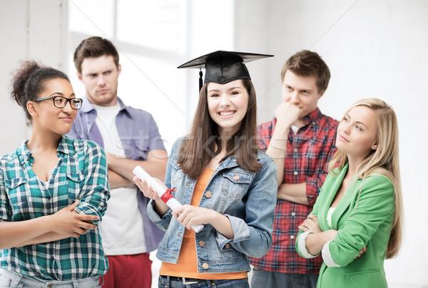 girl in graduation cap with certificate Stock photo © dolgachov