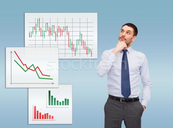 handsome businessman looking up Stock photo © dolgachov