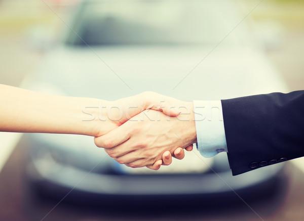 Müşteri satıcı el sıkışmak taşımacılık iş alışveriş Stok fotoğraf © dolgachov