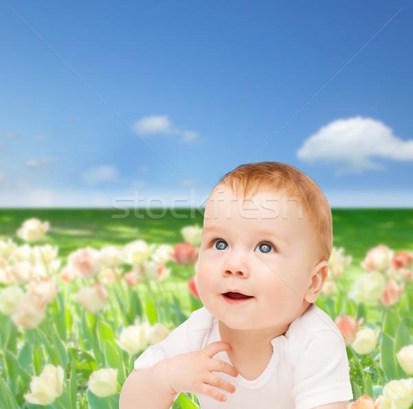 smiling baby looking up Stock photo © dolgachov