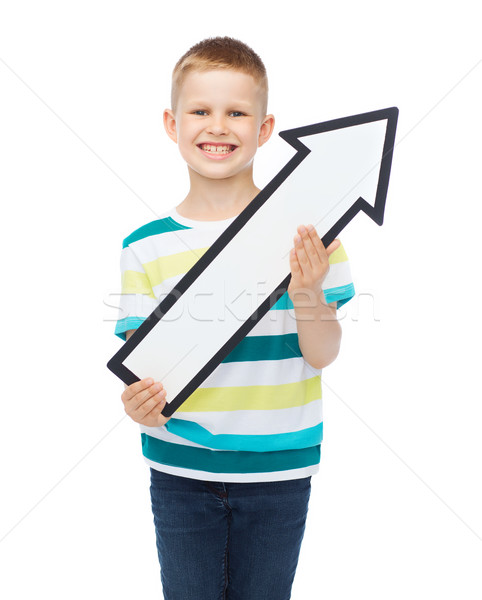 Stock photo: smiling little boy with blank arrow pointing up