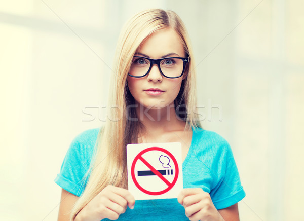 woman with smoking restriction sign Stock photo © dolgachov