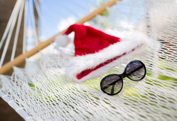 Függőágy mikulás segítő kalap vakáció karácsony Stock fotó © dolgachov