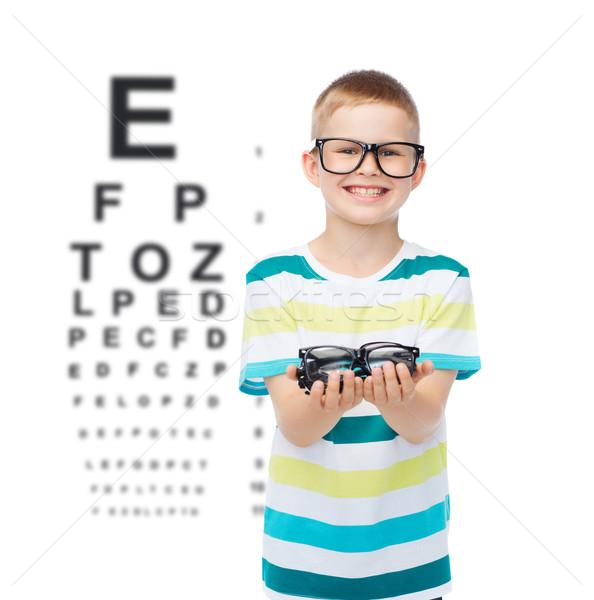 Lächelnd Junge halten Brillen Vision Stock foto © dolgachov