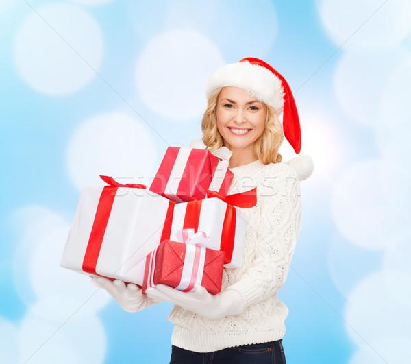 улыбаясь помощник Hat подарки Сток-фото © dolgachov