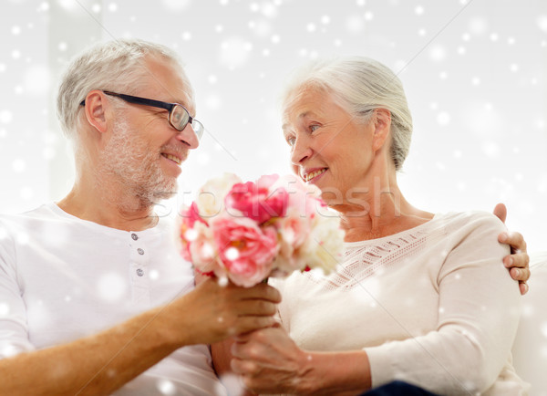 happy senior couple with bunch of flowers at home Stock photo © dolgachov