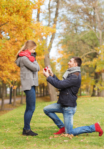 smiling couple with engagement ring in gift box Stock photo © dolgachov