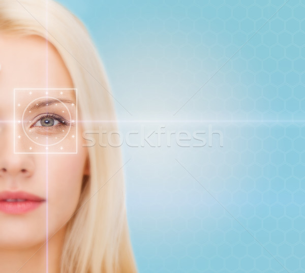 Stock photo: beautiful young woman with laser light lines
