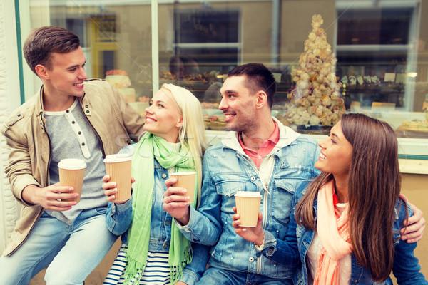 Grupo sonriendo amigos lejos café Foto stock © dolgachov