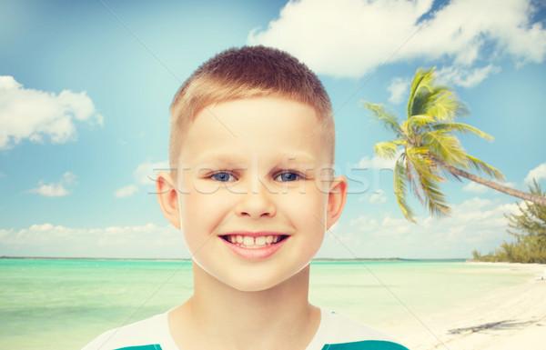 Mosolyog kicsi fiú zöld gyermekkor nyár Stock fotó © dolgachov
