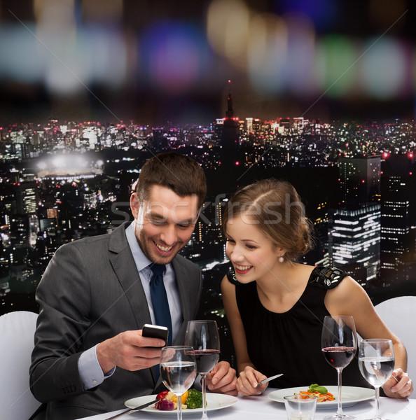 Foto stock: Sonriendo · Pareja · comer · restaurante · tecnología