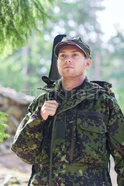 Genç asker avcı tabanca orman avcılık Stok fotoğraf © dolgachov