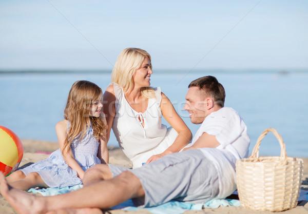 happy family having a picnic Stock photo © dolgachov
