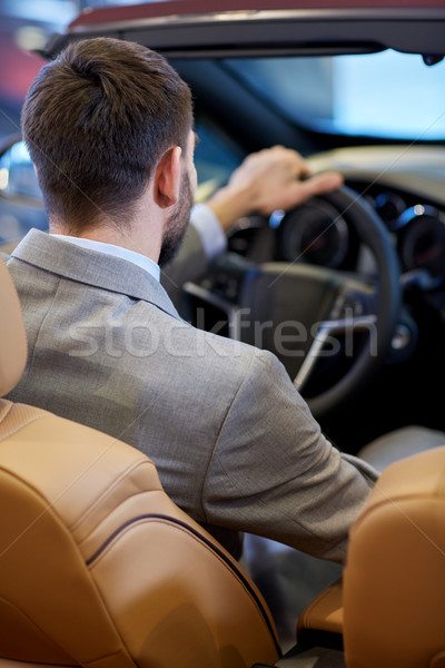 close up of man in cabriolet car at auto show Stock photo © dolgachov