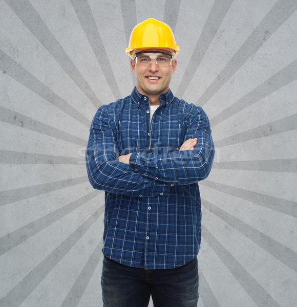 Sorridente masculino construtor manual trabalhador capacete Foto stock © dolgachov
