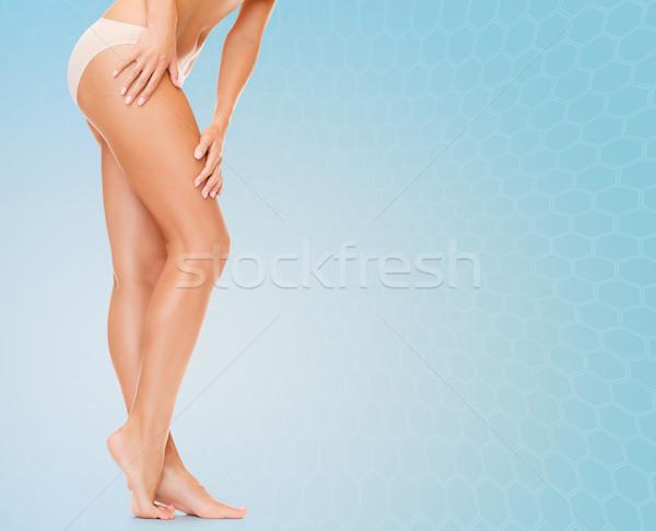 woman long legs in cotton panties Stock photo © dolgachov
