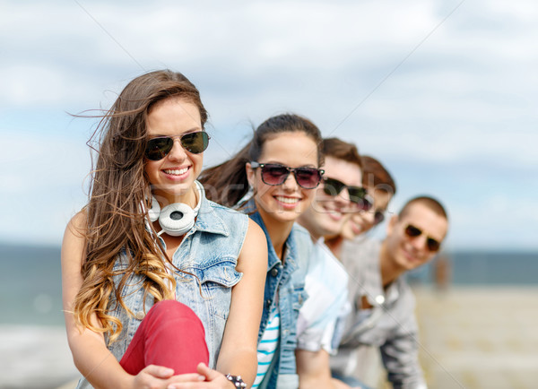 smiling teenage girl hanging out with friends Stock photo © dolgachov