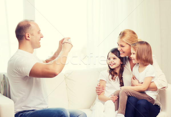 father taking picture of mother and daughters Stock photo © dolgachov
