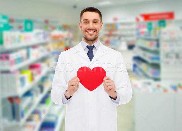 Mężczyzna farmaceuta serca apteka muzyka apteki Zdjęcia stock © dolgachov