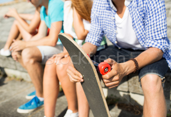 close up of friends with longboard on street Stock photo © dolgachov
