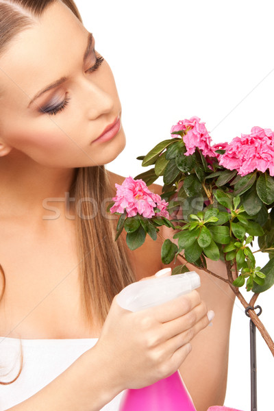 lovely housewife with flowers Stock photo © dolgachov