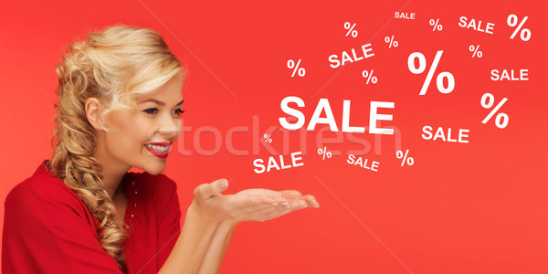 woman with sale and percentage signs over red Stock photo © dolgachov