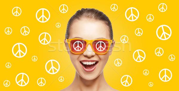 happy teenage hippy girl in shades with peace sign Stock photo © dolgachov