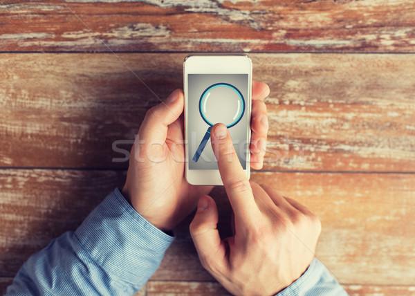 Közelkép kezek nagyító okostelefon üzlet oktatás Stock fotó © dolgachov
