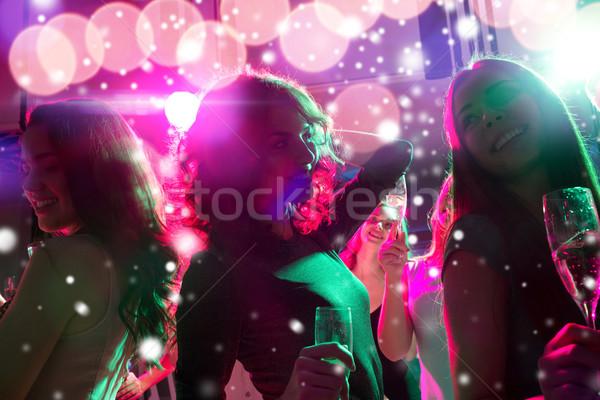 улыбаясь друзей очки шампанского клуба Новый год Сток-фото © dolgachov