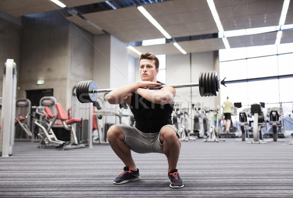 若い男 筋肉 バーベル ジム スポーツ ボディービル ストックフォト © dolgachov