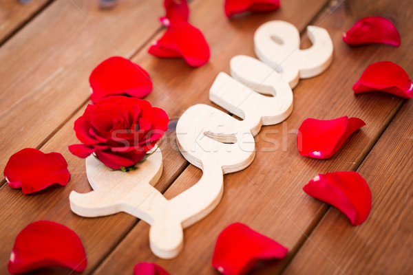 close up of word love cutout with red rose on wood Stock photo © dolgachov