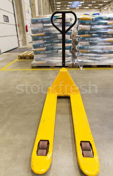 manual loader and cargo piles at warehouse Stock photo © dolgachov