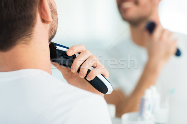 Közelkép férfi szakáll körülvágó szépség emberek Stock fotó © dolgachov
