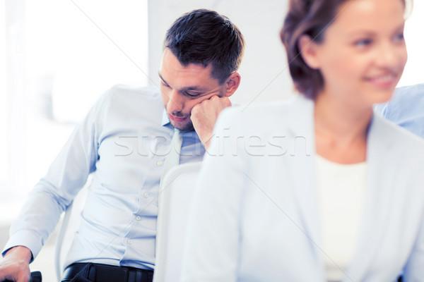tired businessmen sleeping on conference Stock photo © dolgachov