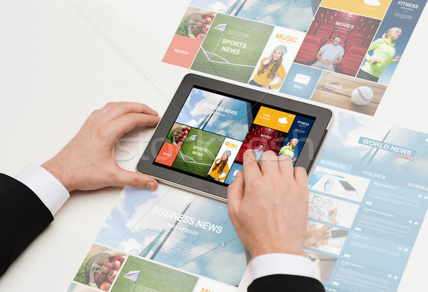 close up of man hands with web pages on tablet pc Stock photo © dolgachov